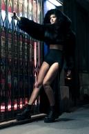 Fur jacket: Kenzo. Sport bra: Nike. High-waist panties: Eres. Tail belt: Jean Paul Gaultier. Boots: Underground.