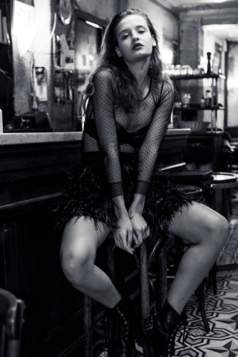 Top: Pinko. Leather bra: Jean Paul Gaultier. Feathers skirt: Alice+Olivia. Boots: Underground.